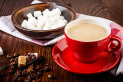 Red cup of coffee with coffee beans Stock Image