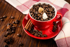 Red cup of coffee with coffee beans and sugar Stock Photography