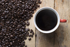 Red cup of coffee and coffee beans Royalty Free Stock Image