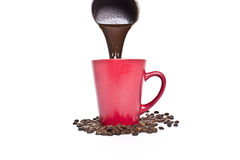 Red a cup of coffee,  coffee beans Royalty Free Stock Image