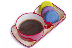 Red cup of coffee and colorful Biscuit isolated on white backgro Stock Photos