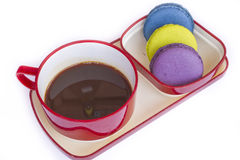 Red cup of coffee and colorful Biscuit isolated on white backgro Royalty Free Stock Photography