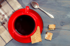 Red cup of coffee with cookie stock image