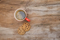 Red cup of coffee and cookies Stock Photography