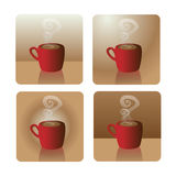 Red cup of coffee. Red coffee cups with steam on golden background Royalty Free Stock Image