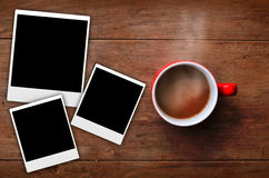 Red cup coffee with frame. Red cup coffee with three frame picture on wood background Royalty Free Stock Photos