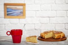 Red cup of coffee with handmade sponge cake stock image