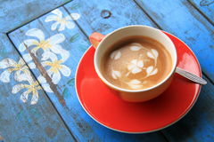 Red cup of coffee with heart and flower painted on foam Stock Image