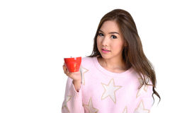 Red cup of coffee in pretty girl hand. Royalty Free Stock Image