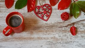 Red cup of coffee, red heart and autumn leaves on wooden background. Red cup of coffee, red heart and colorful autumn leaves on old white background Stock Photos