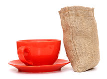 Red cup of coffee with sack of coffee beans Royalty Free Stock Photos