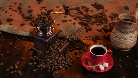Red cup with coffee on saucer with pieces of sugar stock video footage