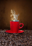 Red cup of coffee with steam Stock Photos