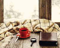 Red cup of coffee or tea on stylized wooden windowsill. Stock Photos