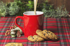 Red cup of coffee, vanilla cookies with chocolate chips Stock Images