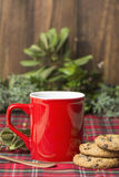 Red cup of coffee, vanilla cookies with chocolate chips Stock Photos