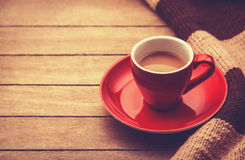 Red cup of the coffee and vintage scarf. Stock Images