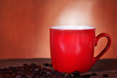 Red cup coffee on wood background Royalty Free Stock Photography