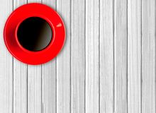 Red cup of coffee on wooden Royalty Free Stock Image