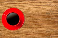 Red cup of coffee on wooden Stock Images