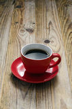 Red Cup. Of coffee on a wooden table Royalty Free Stock Images