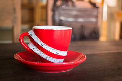 Red cup of coffee on wooden table Royalty Free Stock Image