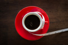 Red cup of coffee on wooden table Royalty Free Stock Images