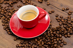Red cup espresso on a black brown table Royalty Free Stock Images