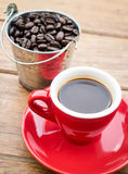 Red cup of espresso on wooden table Royalty Free Stock Images