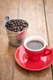 Red cup of espresso on wooden table Stock Image