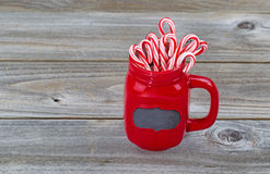 Red Cup filled with Candy Canes for the holiday season Royalty Free Stock Photography