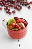Red cup with fruits Royalty Free Stock Photography