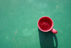 Red cup on green Stock Images