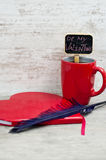 Red cup heart shaped notepad and quill. Valentine's day concept Stock Image