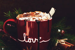 Red cup with hot chocolate with cream, close-up Royalty Free Stock Images