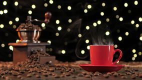 Red cup of hot coffee with smoke. Background with lights stock footage