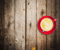 Red cup and latte coffee on wood table Stock Image