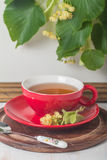 Red cup of linden tea Stock Images