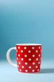 Red cup of milk on a blue background Royalty Free Stock Photo