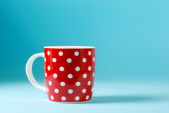 Red cup of milk Royalty Free Stock Photography