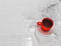 Red cup on the napkin, Royalty Free Stock Photography