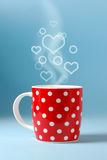 Red cup over beautiful blue sky background. With copy space Stock Photo