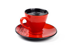 Red cup and saucer Stock Image