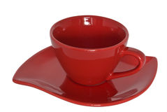 Red cup and saucer. Close-up. Royalty Free Stock Images