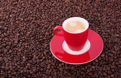 A red cup and saucer with coffee Royalty Free Stock Images