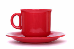 Red cup with a sauser Royalty Free Stock Photo
