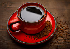 A red cup of tasty instant coffee, on wooden surface Royalty Free Stock Photos