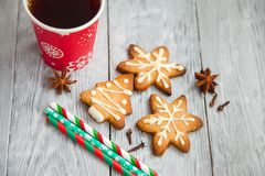 Red cup of tea and Christmas cookies stock images