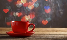 Red cup of tea in heart bokeh background Stock Photos