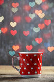 Red cup of tea in heart bokeh background Stock Image